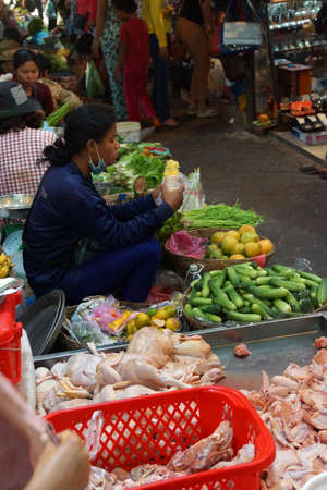 siem: SIEM REAP, CAMBODIA - FEB 16, 2015 - Woman selling vegetables in the market of  Siem Reap,  Cambodia