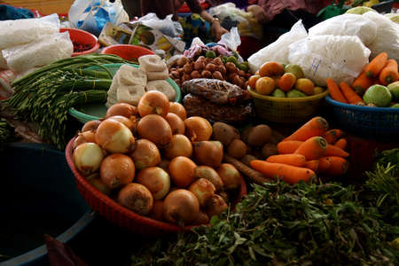 central market: Greens and other vegetables for sale  at the Kratie central market,  Cambodia