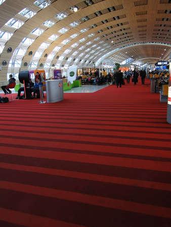 PARIS - FEB 21, 2011 - Passengers wait for their flights  at Charles de Gaulle Airport in Paris.