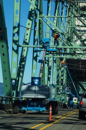 ironwork: SEASIDE, OREGON - SEP 28, 2014 - Maintenace work on the  Steel bridge over the Columbia River, Astoria, Oregon Editorial
