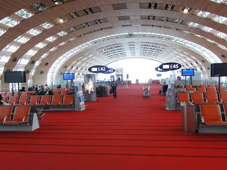 charles de gaulle: PARIS - FEB 21, 2011 - Passengers wait for their flights  at Charles de Gaulle Airport in Paris.