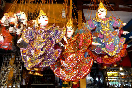 puppets: Traditional  puppets hanging on display  in the old Market of  Siem Reap,  Cambodia Stock Photo