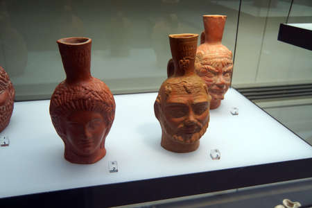 COLOGNE, GERMANY - SEP 15, 2016 - Head shaped pitchers from ancient Roman times,  Roman - Germanic Museum,  Cologne, Germany