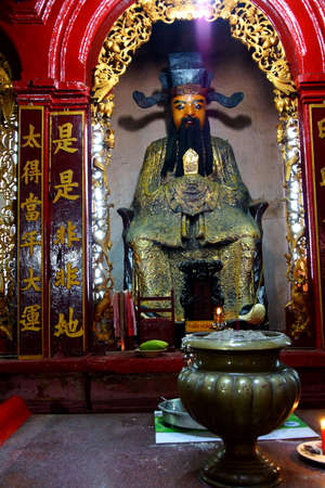 SAIGON - FEB 5, 2015 - Small altar with offerings in  Emperor Jade Pagoda, Chua Phouc Hai pagoda, Saigon (Ho Chi Minh City),  Vietnam