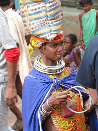 weekly market: ORISSA,  INDIA - NOV 12, 2009 - Bonda tribal woman with elaborate necklaces and earrings weekly market  in Ankadeli, Orissa in India Editorial