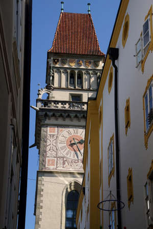 PASSAU, GERMANY - SEP 8, 2016 - Narrow street with Clock Tower of Town Hall,  Passau, Germany