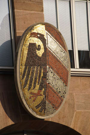 sigil: NUREMBERG, GERMANY - SEP 10, 2016 - Coat of arms decorating town building in  Nuremberg, Germany
