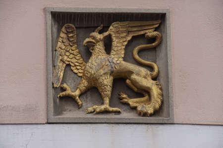 sigil: NUREMBERG, GERMANY - SEP 10, 2016 - Griffin coat of arms on town building in  Nuremberg, Germany