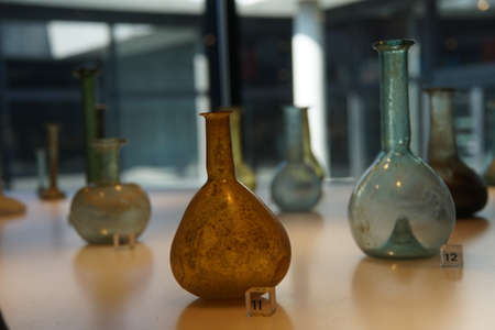 COLOGNE, GERMANY - SEP 15, 2016 - Ancient Roman glass vases,  Roman - Germanic Museum,  Cologne, Germany