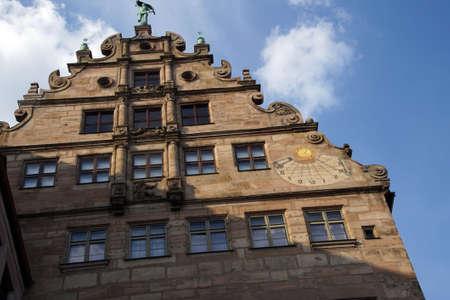 sun dial: NUREMBERG, GERMANY - SEP 10, 2016 - Sun dial on face of City Museum in  Nuremberg, Germany