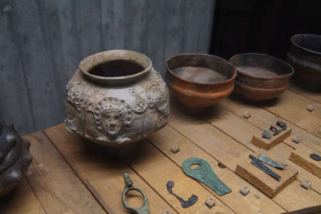 artifacts: COLOGNE, GERMANY - SEP 15, 2016 - Pottery and metal artifacts from ancient Roman times,  Roman - Germanic Museum,  Cologne, Germany Editorial