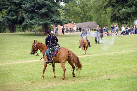 CIVIL WAR BATTLE RE-ENACTMENT, PORT GAMBLE, WA - 20 JUN 2009 -  Cavalry skirmishing in open field,