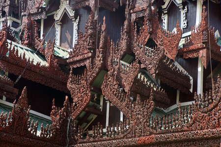 elaborate: Elaborate wood carvings on the roof ridges of a temple at the Shwedagon Pagoda,  Yangon (Rangoon),  Myanmar (Burma)