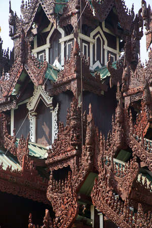 roof ridge: Elaborate wood carvings on the roof ridges of a temple at the Shwedagon Pagoda,  Yangon (Rangoon),  Myanmar (Burma)