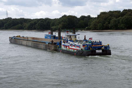 barge: DANUBE RIVER - SEP 5, 2016 - Dredging tug and barge on the Danube River, Slovakia Editorial