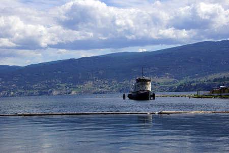 Old tug boat moored on Lake Okanagan, Penticton, British Columbia, Canada..