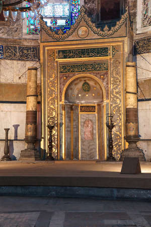 ISTANBUL, TURKEY - MAY 17, 2014 - Mihrab is a semicircular niche in the wall of a mosque that indicates the qibla the direction of the Kaaba in Mecca,  Hagia Sophia  in Istanbul, Turkey