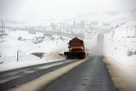 Snowplow sanding winter road near Steamboat Springs,Colorado, Rocky Mountains
