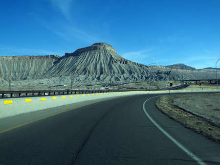 Book cliffs, sedimentary buttes, along I-70 highway near Grand Junction, Colorado