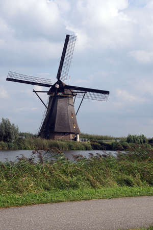 Windmill for pumping water out of polders in  Kinderdijk, Netherlands