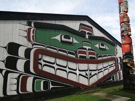 haida indian: Haida painting on side of cedar house, Thunderbird Park, Victoria, BC, Canada