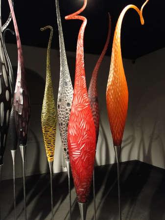 geneva: GENEVA, SWITZERLAND - MAR 4, 2012 -  Slender blown glass designs  in bright colors Geneva, Switzerland