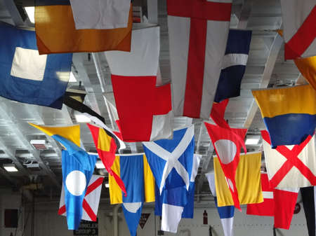 Signal flags displayed on the hangar deck  of on the hangar deck  of the Amphibious Assault Ship Bonhomme Richard, LDH-6,  on Aug 4, 2011, in Seattle. Editorial