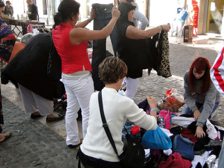 AVIGNON, FRANCE - OCT 2, 2011 - Shoppers search for bargains at a weekly flea market   in Avignon, France.