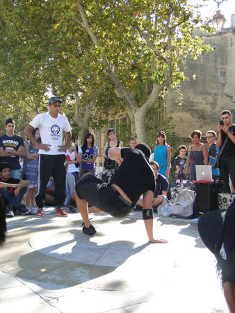 headstand: AVIGNON, FRANCE - OCT 1, 2011 - Hip-Hop breakdancers compete in pairs, Palace of the Popes,  on Oct 1, 2011 in Avignon, France