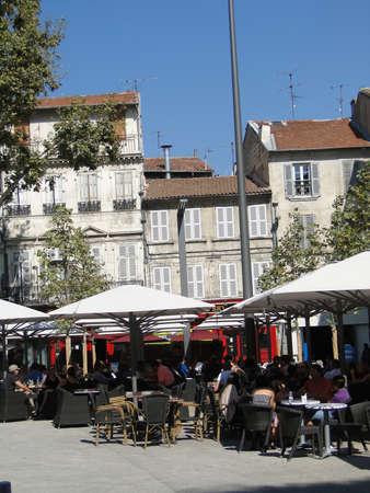 AVIGNON, FRANCE - OCT 1, 2011 - Casual diners enjoy an outside meal Avignon, France
