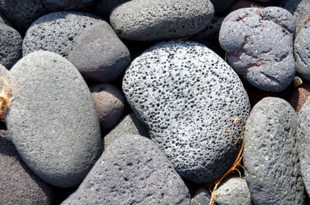 Lava rocks, rounded by the ocean at Napoopoo beach in  Kealakekua Bay State Historical Park Hawaii