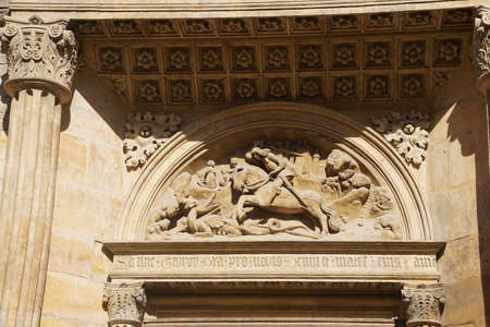 Carving of St George and the dragon on exterior of   St Vitus Cathedral,  Prague, Czech Republic
