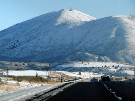 Tracker trailers drive cautiously on icy roads  in Eastern Oregon