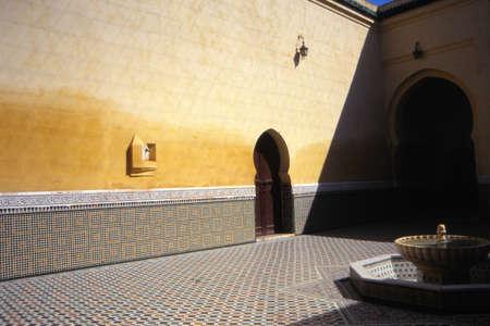 Sundial in courtyard wall, Meknes, Morocco