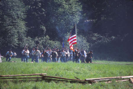 SEATTLE - JUL 10, 1996 - Infantry maneuvers during a Civil War battle reenactment near Seattle