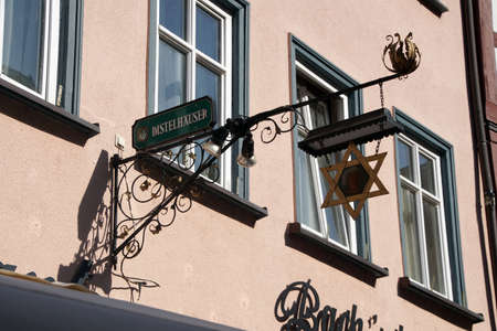 WERTHEIM, GERMANY - SEP 13, 2016 - Shop signs on narrow street in  Wertheim, Germany