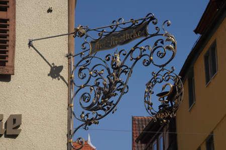 wertheim: WERTHEIM, GERMANY - SEP 13, 2016 - Shop signs on narrow street in  Wertheim, Germany