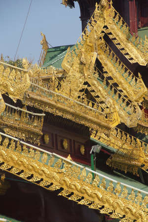 Golden filigree on rooftop of temple at Shwedagon Pagoda Yangon (Rangoon),  Myanmar (Burma)