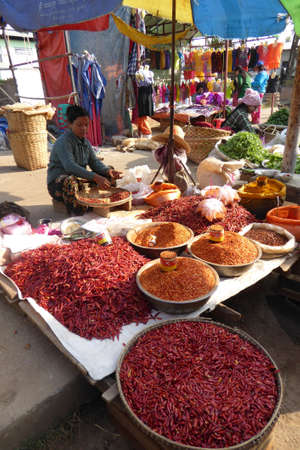 KYAUKME, MYANMAR - FEB 22, 2015 - Selling hot red chile peppers at the central market, Kyaukme Myanmar (Burma)