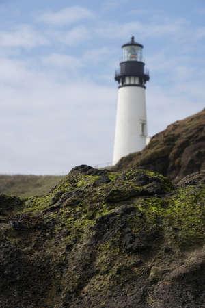 Rugged coastal headlands with Yaquina Head Lighthouse in background,  Newport, Oregon