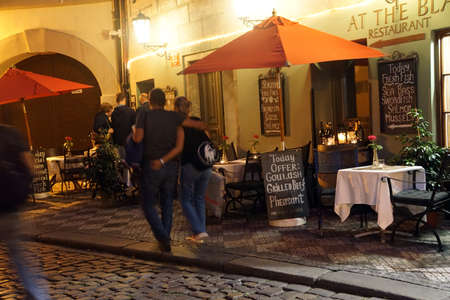 PRAGUE - AUG 31, 2016 - Small restaurant opens for the evening near Stare Mesto, Old Town of  Prague, Czech Republic