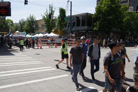 halt: SEATTLE - MAY 21, 2017 - Police halt traffic so people can cross at  the University District Street Fair (oldest in the country),Seattle Editorial