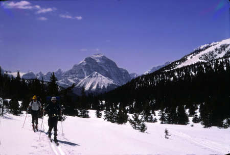 assiniboine: BANFF, ALBERTA - MAR 12, 1979 -Backcountry skiers with Mt Assiniboine in the background, Alberta, Canada Editorial