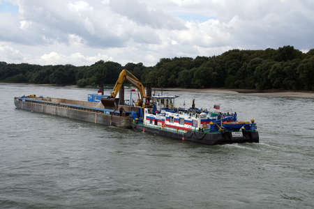 DANUBE RIVER - SEP 5, 2016 - Dredging tug and barge on the Danube River, Slovakia Editorial