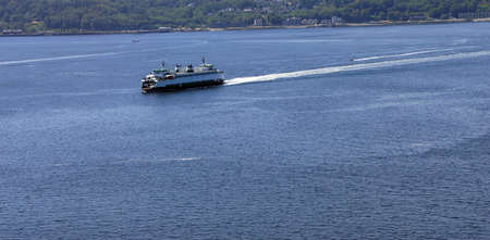 Washington State ferry leaving Seattle to enter Puget Sound ,  Seattle, Washington