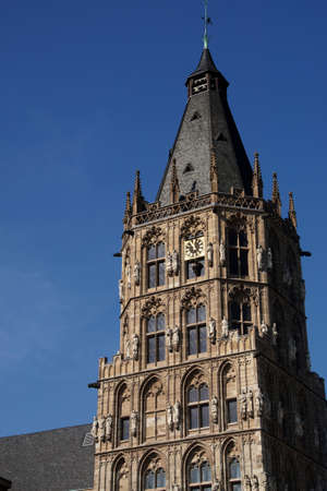 sep: COLOGNE, GERMANY - SEP 15, 2016 - Clock tower with historical statues,  Old Town Hall of  Cologne, Germany