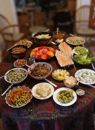 Turkish meze appetizers and salads on serving table in Seattle