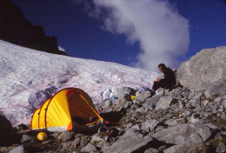 NORTH CASCADES, WASHINGTON - JUL 12, 1980 -High mountain camp with yellow tent near Eldorado Peak,North Cascades National Park,Washington Stock Photo