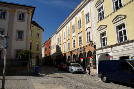 PASSAU, GERMANY - SEP 8, 2016 - Narrow street with shopkeepers and artists signs,  Passau, Germany Editorial