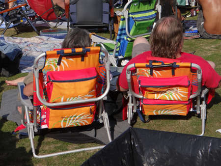 Couple In Orange Lawn Chairs Enjoying The Music At The 4th Of July Weekend  Blues Festival
